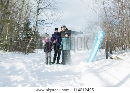 Happy parents and their kids in winterwear