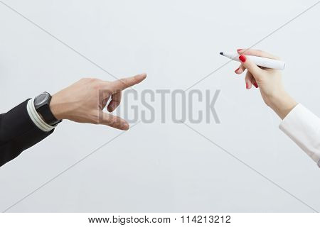 Male and female hands on isolated whiteboard background