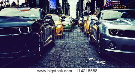NEW YORK CITY - JULY 9: Cars on Times Square an iconic street of New York City and America July 9 2015 in Manhattan New York City. Special photographic processing