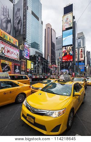 NEW YORK CITY - JULY 8: Taxi on Times Square an iconic street of New York City and America July 8 2015 in Manhattan New York City. Special photographic processing