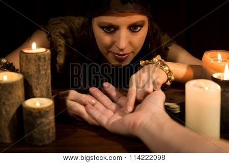 Fortune Teller Is Reading The Lifeline And Heart Line, Concept Palmistry