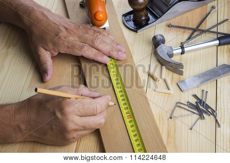 The Man Measures Plate On A Table With Various Accessories To Repair