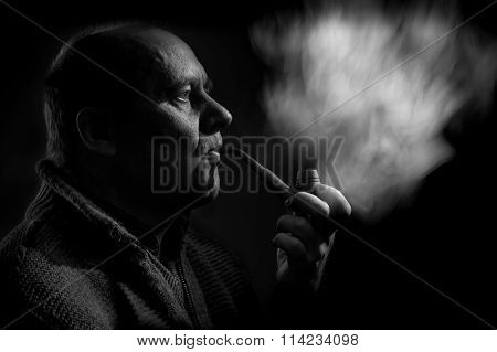 portrait of a caucasian man smoking tobacco pipe