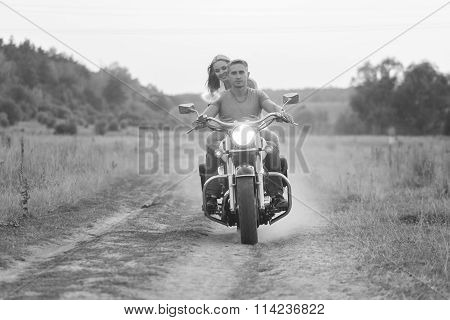 Travel and love, passion, bike road. Couple in love on the road with a motorcycle. Boy and girl in l