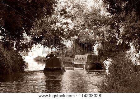 Narrow boats on a British canal, in sepia colours