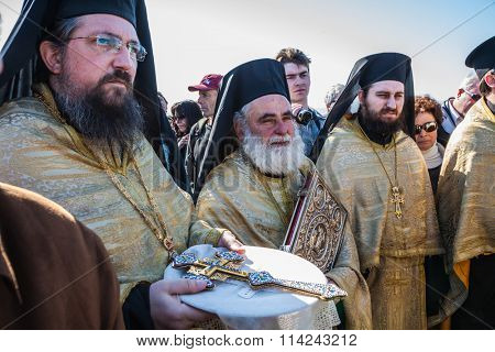 THE BORDER WITH JORDAN, ISRAEL - JANUARY 18, 2008:  Worship are Orthodox priests. The Day of the Christian feast of Baptism of Christ in Jordan River