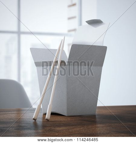 Chinese food box on the wooden table. 3d rendering
