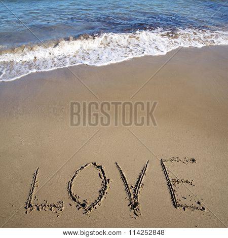 Word Love Written On Sand