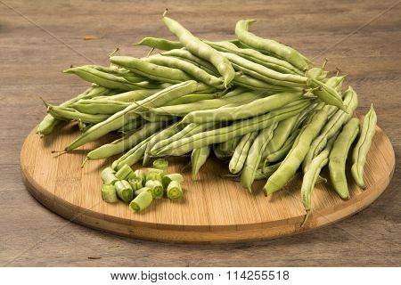 small and slender green beans (haricot vert) on a wood. Fresh vegetable. poster