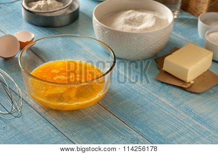 Beaten Eggs With Ingredients For Preparing Baked Products