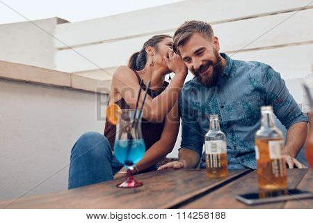 Couple Gossiping During Party