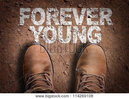 Top View of Boot on the trail with the text: Forever Young