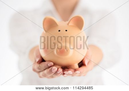 Piggy Bank And Business Concept. Woman Holding Ceramic Piggy Bank In His Hands, Close Up.