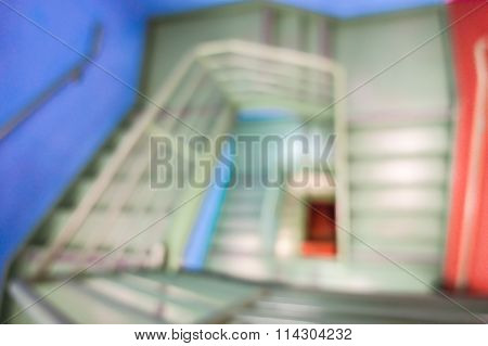 Blurred Defocused Background With Square Spiral Staircase