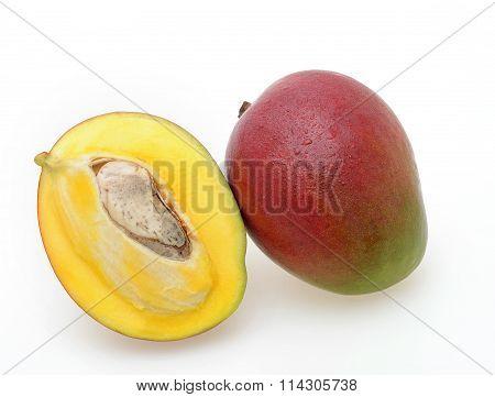 whole and half Ripe mango fruits isolated on white background,