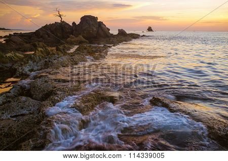 Layangan Labuan Bonzai rock over beautiful sunset.