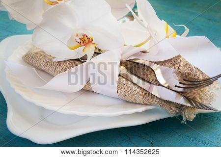 Spring Table Setting With White Orchid Decorations And Napkins O