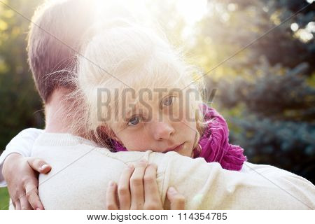 Daddy Reassured His Daughter.little Girl Resting On Her Father's Shoulder