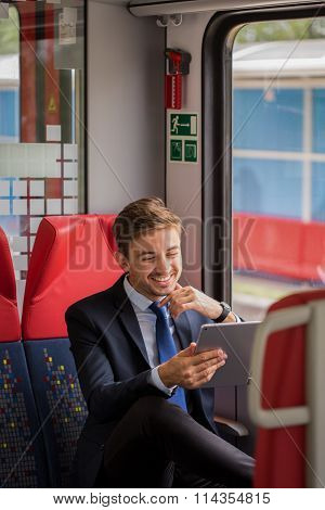 Smiling Commuter With Tablet