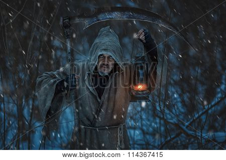 Close-up Portrait Of A Grim Reaper With Scythe.
