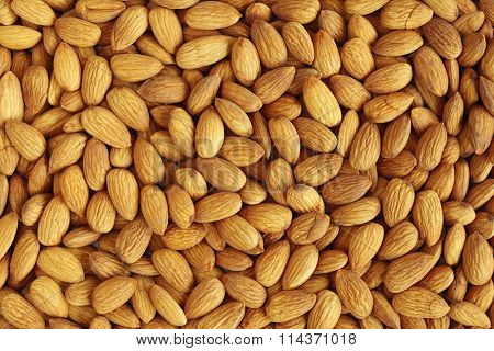 Closeup of whole almond nuts for background