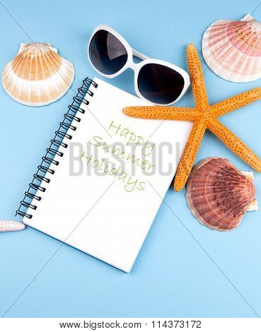 summer background with notebookstarfish and sea shells