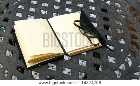 Open Leather Bound Journal Outside On Table