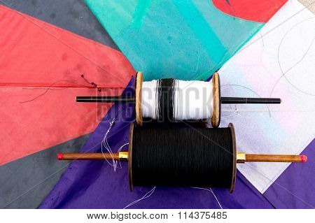 colorful indian paper kites and spool