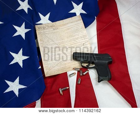 Constitution with Hand Gun & Cartridges on American Flag