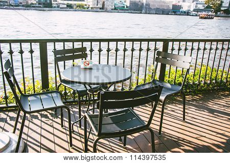 No Smoking sign on Chair and Desk/ Table set on the balcony beside the river Choa Praya River.