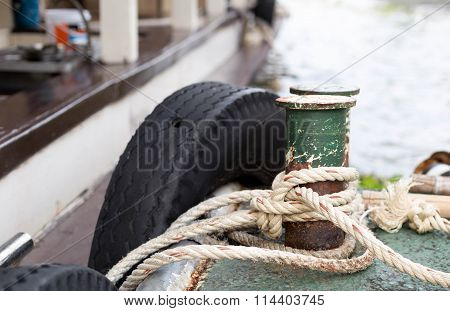 Boat rope tied to the old iron cleats on deck