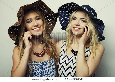 two pretty girls friends with mobile