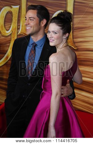 HOLLYWOOD, CALIFORNIA - November 14, 2010. Zachary Levi and Mandy Moore at the Los Angeles premiere of