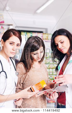 Two Female Doctors Explaining A Product To Client