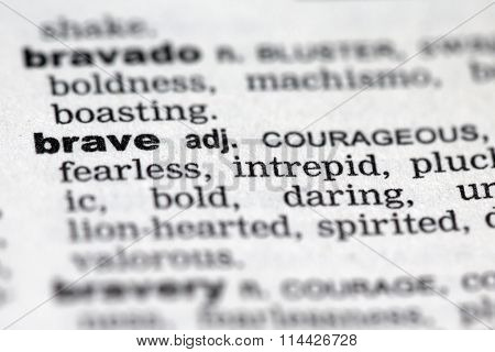 Closeup of the dictionary details of the word brave poster