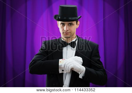 Portrait Of Magician Performing Trick With Cards