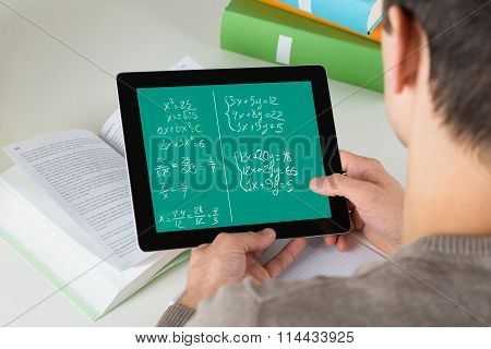 Student Learning Mathematical Equations On Digital Tablet