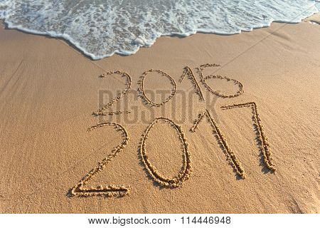 Digits 2017 And 2016 On Coast Sand At Sunset
