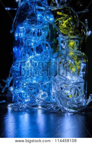 Beautiful Christmas decorations. Glowing light bulb in the bottle.