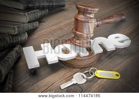 Sign Home, Key, Judges Gavel And Book On Wood Table