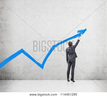 Businessman Painting A Graph