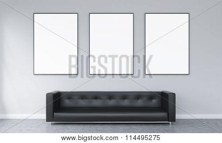 Three Frames Over A Sofa