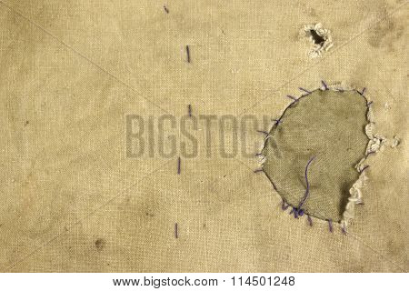 Weathered Military Army  Khaki Camouflage Fabric With Patch, Background Texture