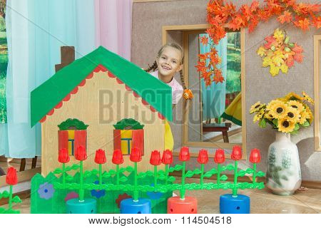 The Girl Looks Out From Behind The Scenery A Country House In The Matinee In Kindergarten