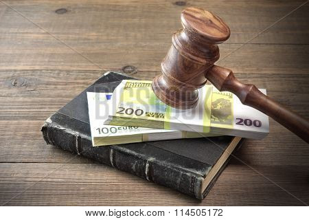 Concept For Corruption Bankruptcy Court Bail Crime Bribing Fraud Auction Bidding. Judges or Auctioneer Gavel And Bundle Of Euro Cash On The Rough Wooden Textured Table Background. Top View poster