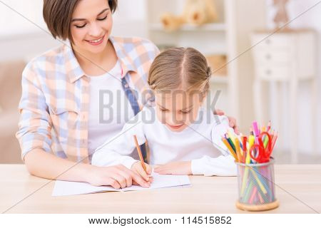 Young lady is busy with a kid.