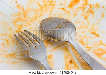 spoon fork after food on white background