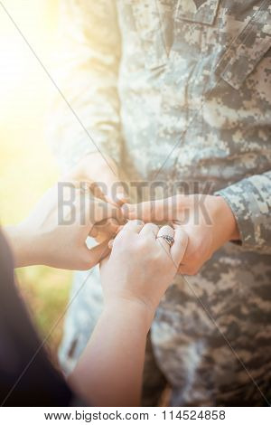 Married Military Couple Holding Hands