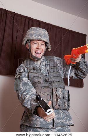 Soldier in combat gear playing video games