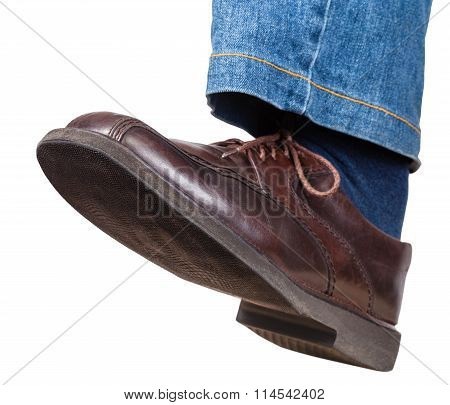 step of male left leg in jeans and brown shoe isolated on white background poster